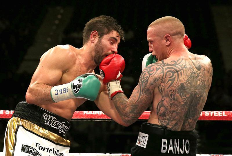 Lee Markham lands a shot on Frank Buglioni