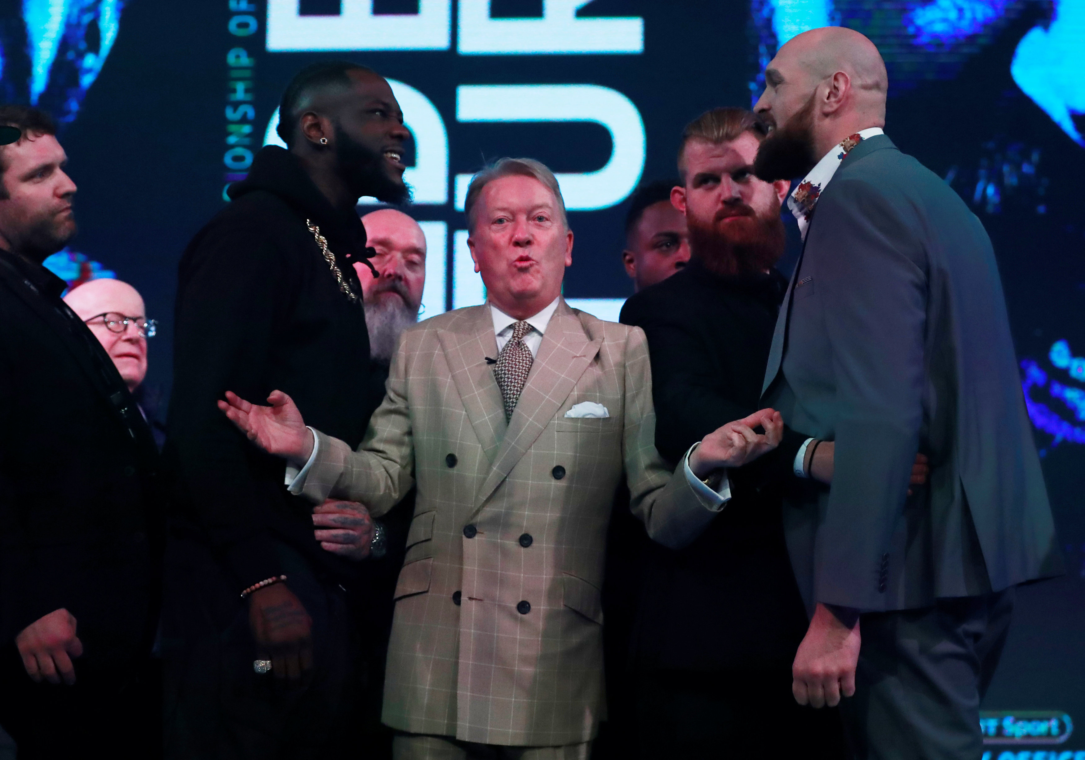 Boxing - Deontay Wilder & Tyson Fury Press Conference - BT Sport Studio, London, Britain - October 1, 2018    Promoter Frank Warren seperates Tyson Fury and Deontay Wilder during the press conference   Action Images via Reuters/Andrew Couldridge